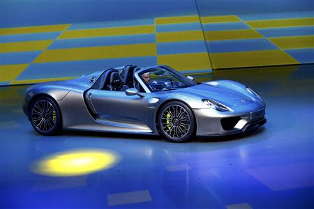 Porsche CEO, Matthias Mueller presents the new Porsche 918 Spyder hybrid car at the Volkswagen group night at the Frankfurt motor show September 9, 2013. REUTERS/Ralph Orlowski