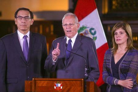 FILE PHOTO: Peruvian President Pedro Pablo Kuczynski  (C) accompanied by his vice-presidents Martin Vizcarra (L) and Mercedes Araoz addresses the nation at the Government Palace in Lima, Peru, December 20, 2017. Peruvian Government Palace/Handout via Reuters.