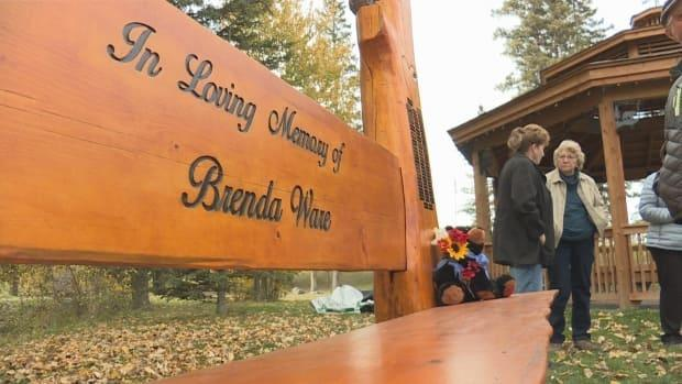 Brenda Ware's family and friends gathered for the unveiling of the hand-carved bench in her honour Saturday.  (Terri Trembath/CBC - image credit)