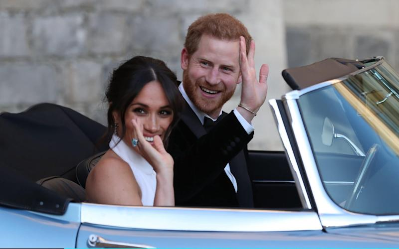 Meghan Markle and Prince Harry, the new Duke and Duchess of Cambridge, leave Windsor castle to attend their evening reception at Frogmore House. The Duchess wears an aquamarine Asprey cocktail ring, believed to be a gift from her husband, that belonged to Princess Diana - Getty Images Europe