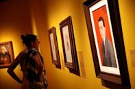 "A visitor attends the ""Frida Kahlo: Masterpieces from the Museo Dolores Olmedo, Mexico City"" exhibition at the Hungarian National Gallery in Budapest, Hungary, August 2, 2018. Picture taken August 2, 2018. REUTERS/Bernadett Szabo"