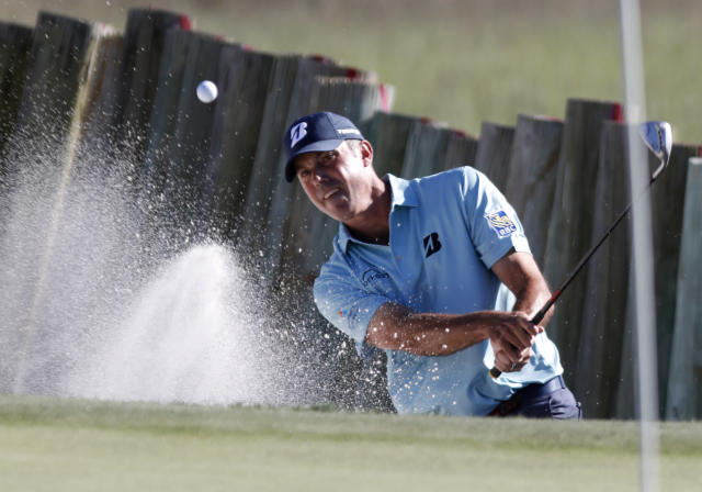 Matt Kuchar blast out of the sand on 17 during the final round of the RBC Heritage golf tournament at Harbour Town Golf Links on Hilton Head Island, S.C., Sunday, April 21, 2019. Kuchar came in second place at 11- under par. (AP Photo/Mic Smith)