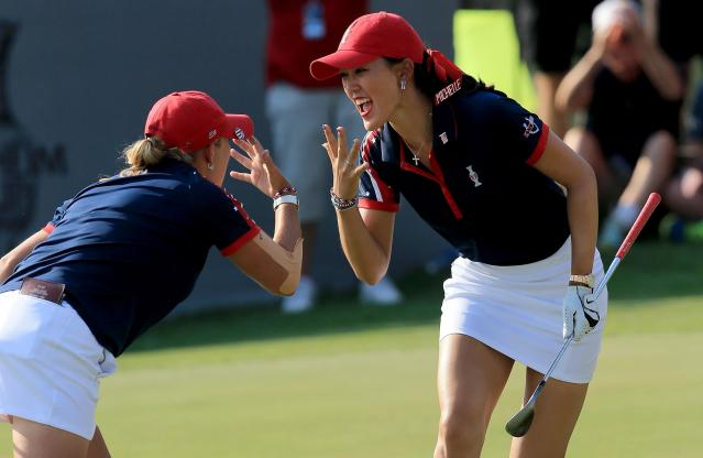 PARKER, CO - AUGUST 16: Michelle Wie of the United States celebrates holing a chip shot at the 13th hole in her match with Cristie Kerr against Charley Hull and Catriona Matthew during the afternoon fourball matches for the 2013 Solheim Cup at The Colorado Golf Club on August 16, 2013 in Parker, Colorado. (Photo by David Cannon/Getty Images)