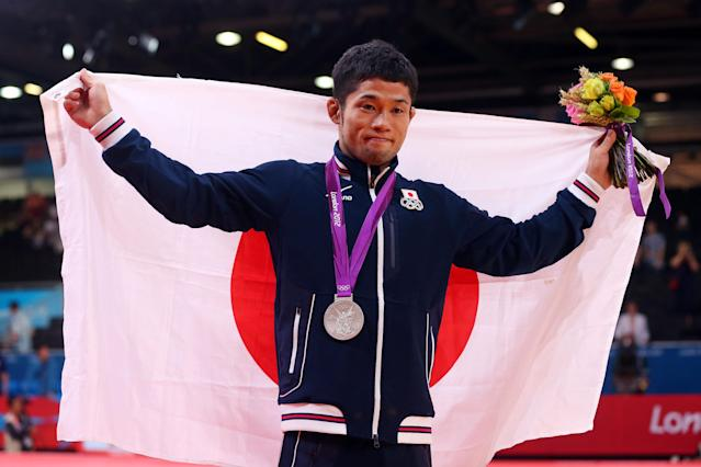 LONDON, ENGLAND - JULY 28: Hiroaki Hiraoka of Japan celebrates winning the silver medal in the Men's -60 kg Judo on Day 1 of the London 2012 Olympic Games at ExCeL on July 28, 2012 in London, England. (Photo by Alexander Hassenstein/Getty Images)
