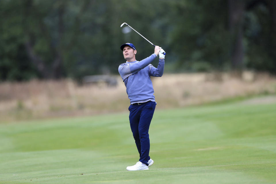 Italy's Lorenzo Scalise plays from the fairway during day one of the British Masters at Close House Golf Club, near Newcastle, England, Wednesday July 22, 2020. The European Tour resumes in earnest after its pandemic-induced shutdown with the British Masters starting Wednesday with plans for players and caddies to be virus tested regularly during the week. (Mike Egerton/PA via AP)
