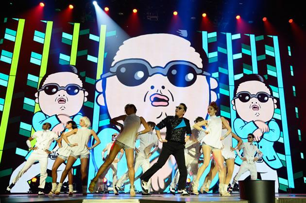 """Fans do """"Gangnam Style"""" dance when they collect tickets. (Getty Images)"""