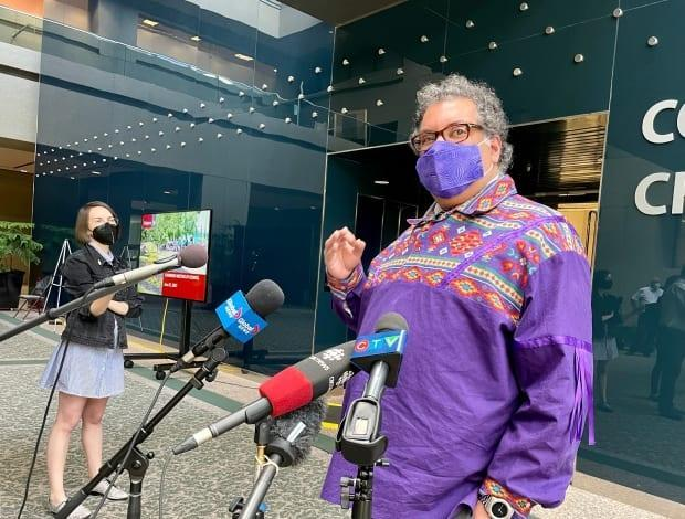 Calgary Mayor Naheed Nenshi said he's optimistic masks will soon no longer be required to keep people safe. But he's not confident that will be the case by July 1, when the province plans to drop nearly all COVID-19 regulations.   (Evelyne Asselin/CBC - image credit)