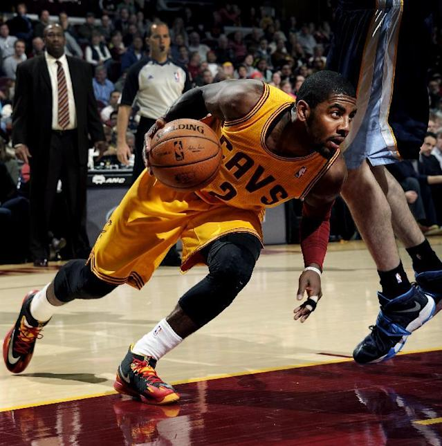 CLEVELAND, OH - FEBRUARY 9: Kyrie Irving #2 of the Cleveland Cavaliers drives against the Memphis Grizzlies at The Quicken Loans Arena on February 9, 2014 in Cleveland, Ohio. (Photo by David Liam Kyle/NBAE via Getty Images)