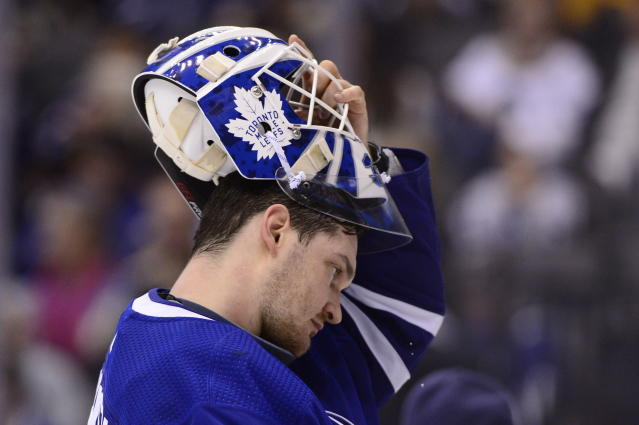 Toronto Maple Leafs goaltender Michael Hutchinson (30) puts his mask back on after a television timeout during the third period of an NHL hockey game against the Boston Bruins, Saturday, Jan. 12, 2019 in Toronto. (Frank Gunn/The Canadian Press via AP)