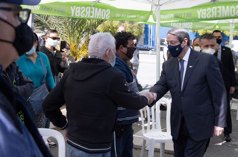 Cypriot President Nicos Anastasiades greets a citizens during a visit at a vaccination centre where his government ministers received a dose of AstraZeneca coronavirus disease (COVID-19) vaccine in Nicosia