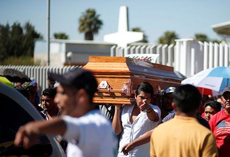 Relatives of a man who died in an explosion of a fuel pipeline ruptured by oil thieves carry his coffin after a funeral mass at a church in the municipality of Tlahuelilpan, state of Hidalgo, Mexico January 21, 2019. REUTERS/Mohammed Salem
