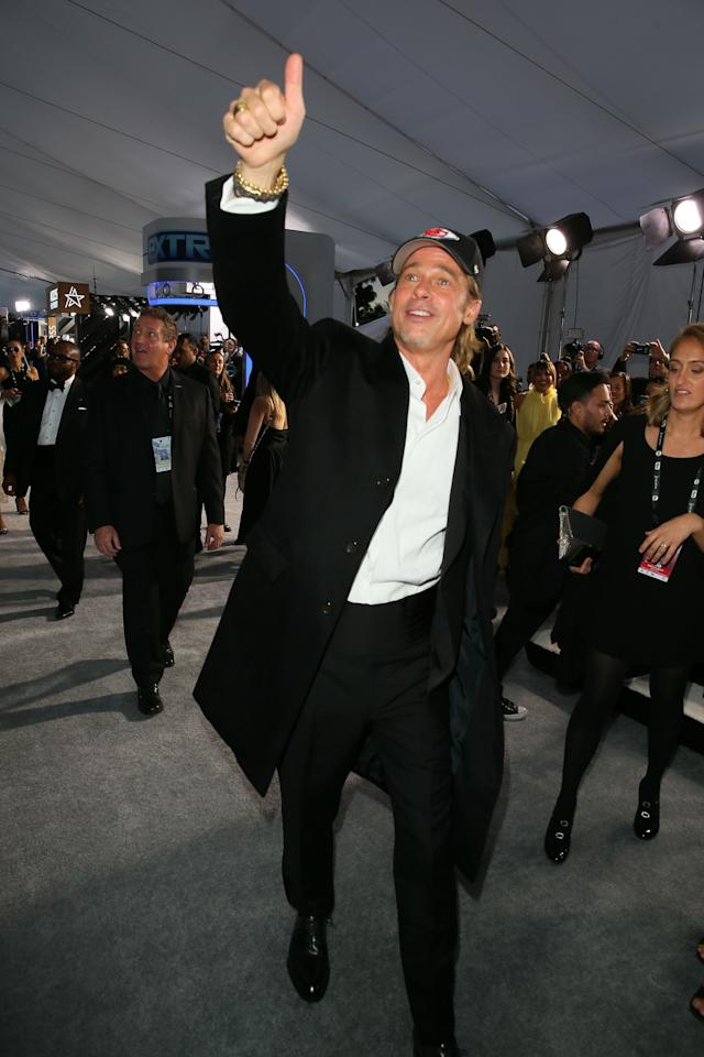 <p>WHAT: Brioni and a Kansas City Chiefs hat by '47</p> <p>WHERE: The SAG Awards</p> <p>WHEN: January 19, 2020</p> <p>WHY: In a baseball cap and loads of gold jewelry, Brad Pitt is the king of the SAGs.</p>