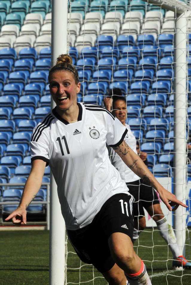 Germany's Anja Mittag celebrates after scoring her side's second goal during the women's soccer Algarve Cup final match between Germany and Japan at the Algarve stadium, outside Faro, southern Portugal, Wednesday, March 12, 2014. (AP Photo/Francisco Seco)
