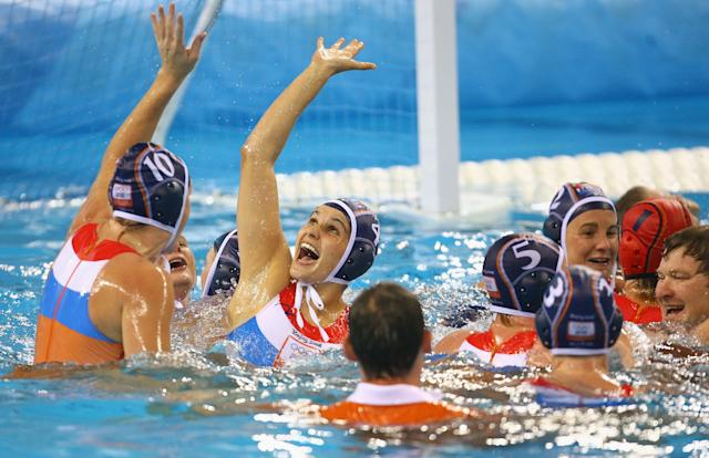 BEIJING - AUGUST 21: The Netherlands team celebrate in the pool after winning the gold medal water polo match against the United States held at the Yingdong Natatorium of National Olympic Sports Center during Day 13 of the Beijing 2008 Olympic Games on August 21, 2008 in Beijing, China. (Photo by Adam Pretty/Getty Images)