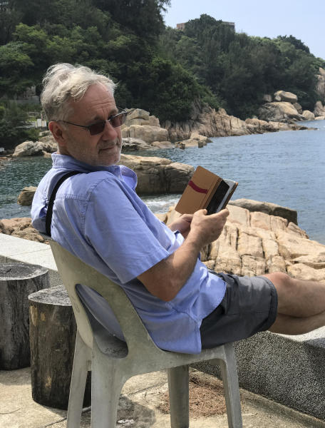 CORRECTS THAT WOLF DIED WEDNESDAY, NOT TUESDAY - Award-winning Hong Kong-based photographer Michael Wolf is photographed in Cheung Chau, Hong Kong in 2016. Hong Kong art gallery director Sarah Greene said that Wolf, known for his work depicting mega-cities, has died Wednesday, April 24, 2019 at his home. She said he was 64. Wolf won first prize in the World Press Photo competition in 2005 and 2010. (Blue Lotus Gallery via AP)