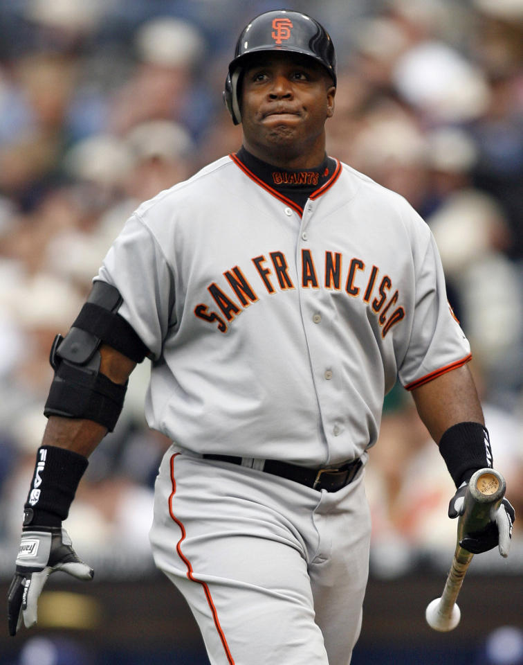 FILE - In this April 3, 2006, file photo, San Francisco Giants' Barry Bonds grimaces as he walks back to the dugout after flying out during the sixth inning of a baseball game against the San Diego Padres in San Diego. With the cloud of steroids shrouding many candidacies, baseball writers may fail for the only the second time in more than four decades to elect anyone to the Hall. (AP Photo/Denis Poroy, File)