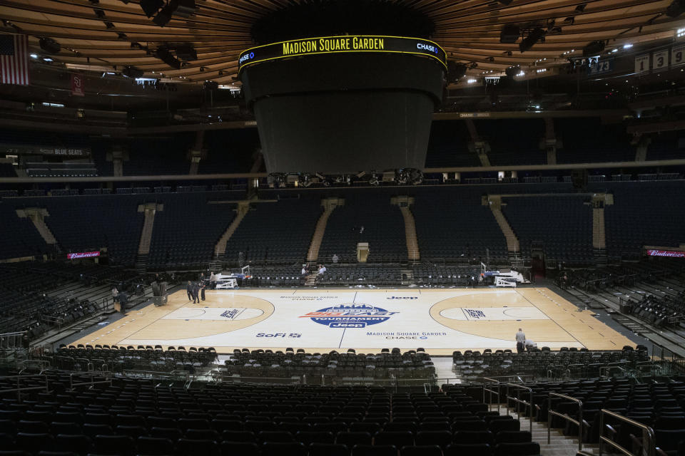 FILE - In this March 12, 2020, file photo, Madison Square Garden in New York sits empty after NCAA college basketball games in the men's Big East Conference tournament were cancelled due to concerns about the coronavirus. With the virus raging in March, several conferences called off their postseason basketball tournaments, and the NCAA canceled the billion-dollar bonanza known as March Madness, proceeds from which trickle down in some form to almost every Division I school in America. (AP Photo/Mary Altaffer, File)