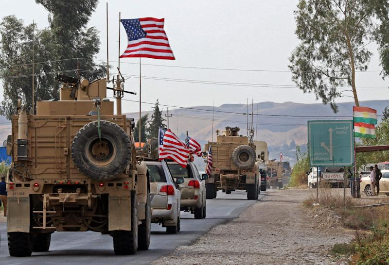 A convoy of US military vehicles arrives near the Iraqi Kurdish town of Bardarash in the Dohuk governorate after withdrawing from northern Syria on October 21, 2019.