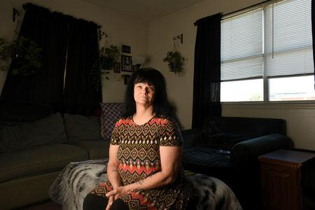 Cathy Sellars at her home in Fort Walton Beach, Florida, U.S. December 21, 2017. She is one of three women who filed a class action lawsuit claiming widespread sexual harassment at their former employer, CRST Expedited, Inc., a large long-haul trucking company in October 2015.  REUTERS/Michael Spooneybarger/Files