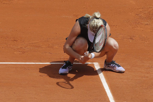 Russia's Anastasia Potapova reacts in her first round match against Germany's Angelique Kerber at the French Open tennis tournament at the Roland Garros stadium in Paris, Sunday, May 26, 2019. (AP Photo/Michel Euler )