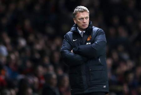 Manchester United's manager Moyes watches during their English Premier League soccer match against Cardiff City in Manchester, northern England
