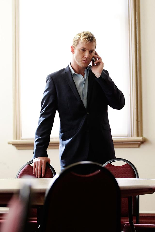 SYDNEY, AUSTRALIA - JULY 13:  Australian cricketer Brett Lee speaks on the phone prior to addressing media representatives at a press conference to announce his retirement from International Cricket at the SCG on July 13, 2012 in Sydney, Australia.  (Photo by Brendon Thorne/Getty Images)
