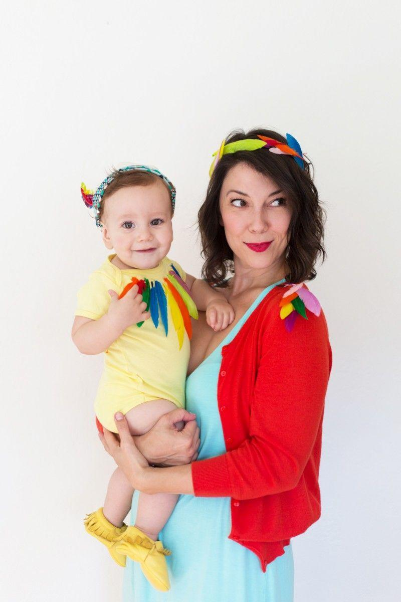 """<p>You know what they say—birds of a feather flock together. Take flight with your little one dressed in matching punny looks. </p><p><strong>Get the tutorial at <a href=""""https://lovelyindeed.com/diy-birds-of-a-feather-mom-baby-halloween-costume/"""" rel=""""nofollow noopener"""" target=""""_blank"""" data-ylk=""""slk:Lovely Indeed"""" class=""""link rapid-noclick-resp"""">Lovely Indeed</a>.</strong></p><p><strong> <a class=""""link rapid-noclick-resp"""" href=""""https://www.amazon.com/Coceca-Colorful-Feathers-Wedding-Decorations/dp/B06VWKVZH1/?tag=syn-yahoo-20&ascsubtag=%5Bartid%7C10050.g.21600836%5Bsrc%7Cyahoo-us"""" rel=""""nofollow noopener"""" target=""""_blank"""" data-ylk=""""slk:SHOP FEATHERS"""">SHOP FEATHERS</a></strong><strong><br></strong></p>"""