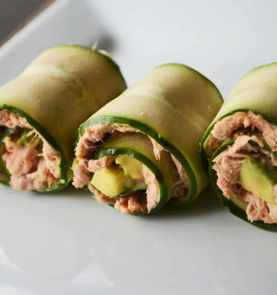 """<p>Using cucumber instead of rice as the wrap makes these rolls by<a href=""""https://www.heyketomama.com/5-minute-spicy-tuna-rolls-2/"""" rel=""""nofollow noopener"""" target=""""_blank"""" data-ylk=""""slk:Hey Keto Mama"""" class=""""link rapid-noclick-resp""""> Hey Keto Mama</a> a healthy, low carb dinner. Plus, there are tons of filling fats from the tuna and avocado to keep late-night munchies at bay. The mayo and sriracha add a punch of flavor, and it takes only five minutes to throw together.</p>"""