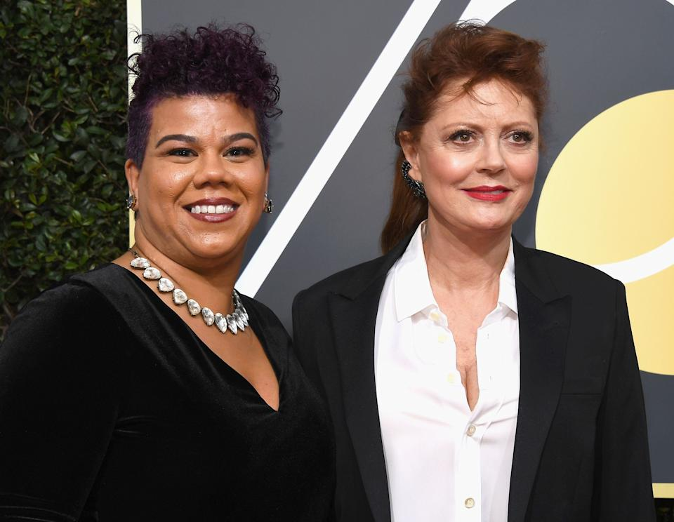 """<a href=""""http://rosaclemente.net/biography-of-rosa-clemente/"""">Rosa Clemente</a>, who attended the Golden Globes with Susan Sarandon,is an <a href=""""http://news.cornell.edu/stories/2017/01/alumna-activist-rosa-clemente-reflect-mlks-legacy"""">activist and independent journalist</a> focusing on issues affecting black and Latinx communities. She's the president and founder of <a href=""""http://www.thefeministwire.com/2013/07/feminists-we-love-rosa-clemente/"""">Know Thy Self Productions</a>, which <a href=""""http://rosaclemente.net/biography-of-rosa-clemente/'"""">produces</a> community activism tours that center around hip-hop activism, immigrants' rights and voter engagement in youth communities of color. <br /><br />In 2008, Clemente was the vice presidential nominee on the Green Party ticket. Today, she is a doctoral student atthe University of Massachusetts,Amherst. <br /><br />""""Our sisterhood is strong, it's always been strong. Now we need men to be allies and accomplices in smashing sexual violence,"""" Clemente said in a red carpet <a href=""""https://twitter.com/rosaclemente/status/950327670629265408"""">interview with Access Hollywood</a>on Sunday night. """"It can't just be because you have a daughter or mother, it has to be because we are human beings that deserve the right to dignity, whether we're working on a Hollywood set or we're working at Kentucky Fried Chicken, whether we're a mother in the South Bronx or we're a mother in Beverly Hills."""""""