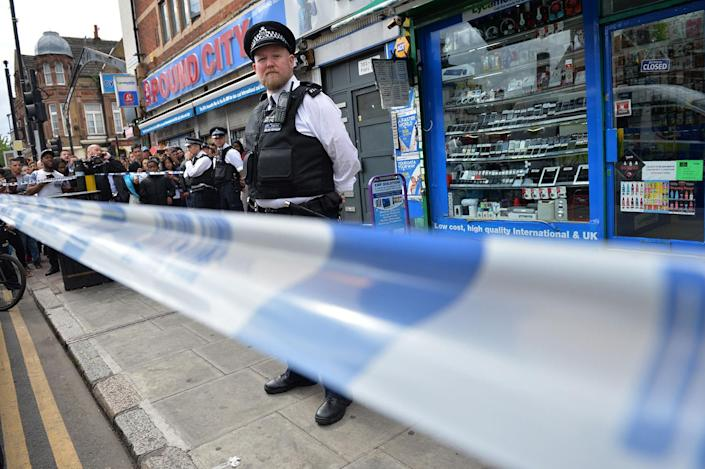 <p>A police officer stands outside a store in East Ham in London, June 4, 2017, following a raid as police continue their investigations following the June 3 terror attacks in central London. (Photo:Justin TallisAFP/Getty Images) </p>
