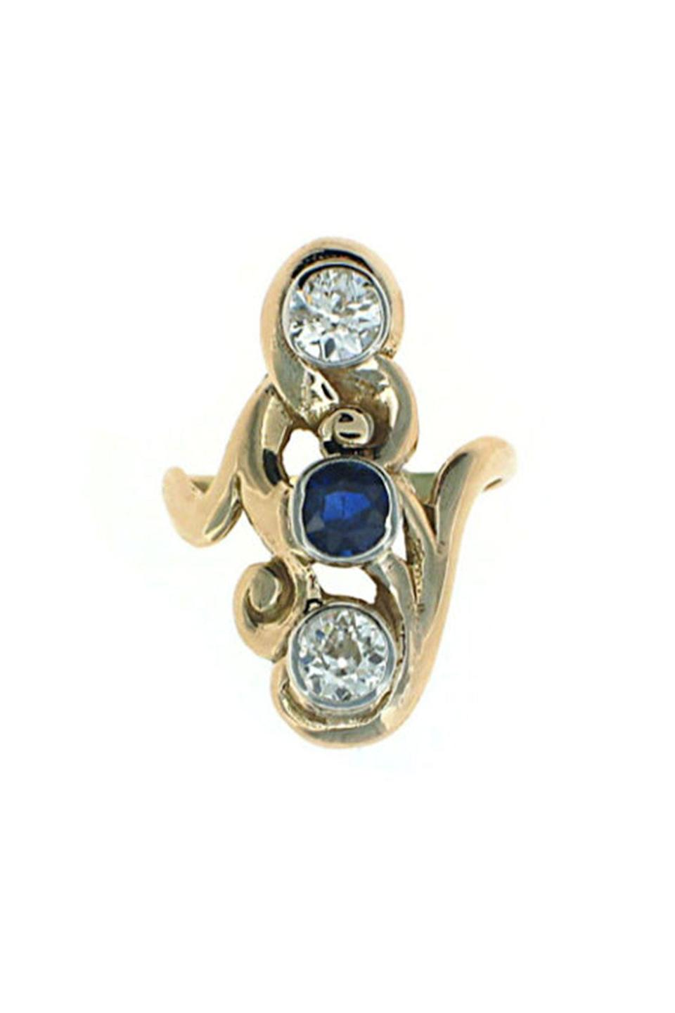"""<p><strong>Beladora</strong></p><p>beladora.com</p><p><strong>$2450.00</strong></p><p><a href=""""https://www.beladora.com/jewelry/500616-antique-art-nouveau-sapphire-and-diamond-ring-in-14k/"""" rel=""""nofollow noopener"""" target=""""_blank"""" data-ylk=""""slk:Shop Now"""" class=""""link rapid-noclick-resp"""">Shop Now</a></p><p>Two bezel-set old mine cut diamonds and a center blue sapphire are set in an elongated and swirling design characteristic of the period. </p>"""