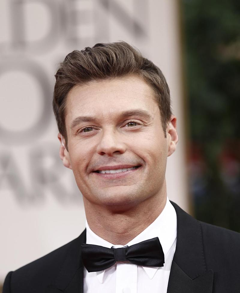 """File - In a Jan. 15, 2012 file photo, Ryan Seacrest arrives on the red carpet to the 69th Annual Golden Globe Awards, in Los Angeles. Seacrest announced on Wednesday's April 4, 2012 """"Today"""" show that he'll be taking part in NBC's coverage of the Summer Olympics.  (AP Photo/Matt Sayles, File)"""