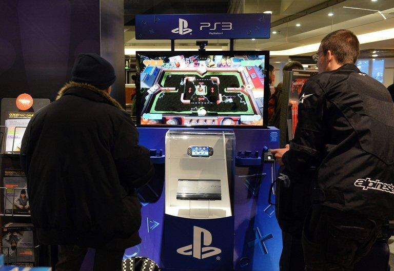 Customers try out a PlayStation 3 game console displayed at a FNAC store on November 27, 2012 in Paris. Sony will this month announce the late 2013 launch of its latest PlayStation console, Japanese media said Thursday, as is looks to its games business in a bid to repair its tattered finances