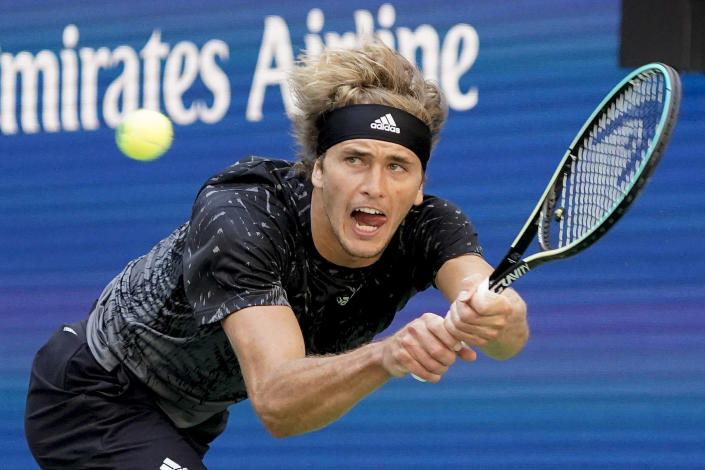 Alexander Zverev, of Germany, returns a shot to Albert Ramos-Vinolas, of Spain, during the second round of the US Open tennis championships, Thursday, Sept. 2, 2021, in New York. (AP Photo/Elise Amendola)