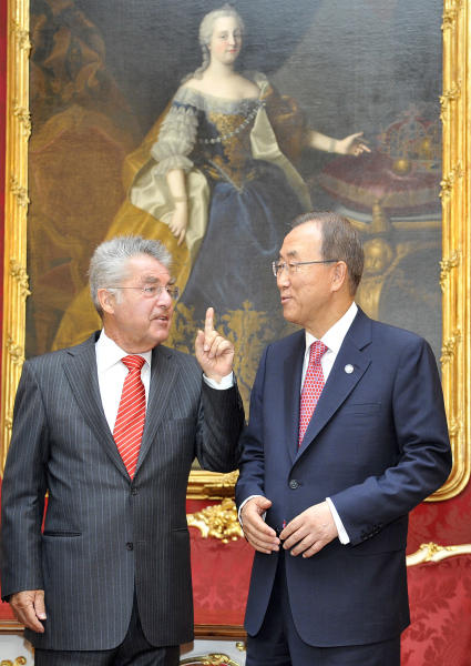 Austrian President Heinz Fischer, left, talks to UN Secretary General Ban Ki-moon at the Hofburg palace in Vienna, Austria on Thursday, August 29, 2013. Ban says the UN inspectors investigating the the alleged chemical attack in Syria will be leaving the country on Saturday. He asked for time for the inspection team to complete its investigation. He says all opinions should be heard before anyone makes decisions on how to react to the alleged attacks. Painting in the background shows late Austrian Empress Maria Theresia. (AP Photo/Hans Punz)