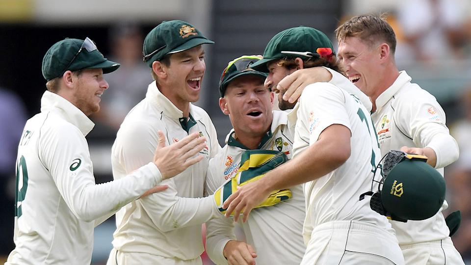 Tim Paine celebrates with his side after a big first Test win over Pakistan. Pic: Getty
