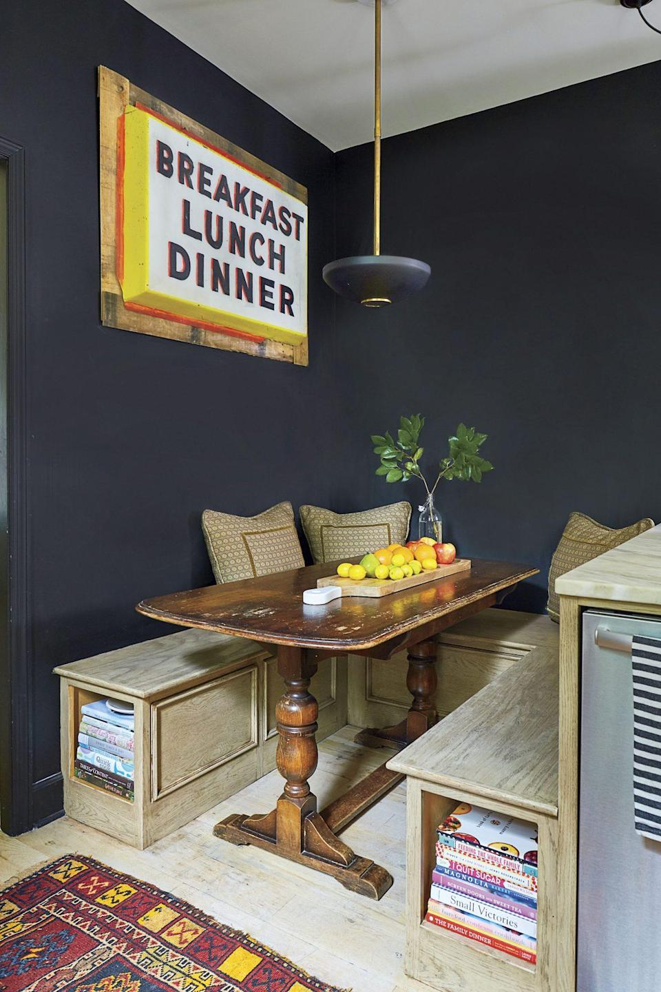 """<p>In Fran Keenan's <a href=""""https://www.southernliving.com/home/decor/small-cottage-decor-dark-accents"""" rel=""""nofollow noopener"""" target=""""_blank"""" data-ylk=""""slk:Birmingham, Alabama, cottage,"""" class=""""link rapid-noclick-resp"""">Birmingham, Alabama, cottage,</a> dramatic black walls make the perfect backdrop for vintage signs, a staple of farmhouse style. If you're looking for farmhouse paint colors that offer an equally bold look, try <a href=""""https://www.benjaminmoore.com/en-us/color-overview/find-your-color/color/2129-20/soot?color=2129-20"""" rel=""""nofollow noopener"""" target=""""_blank"""" data-ylk=""""slk:Benjamin Moore Soot (2129-20)"""" class=""""link rapid-noclick-resp"""">Benjamin Moore Soot (2129-20)</a>.</p>"""