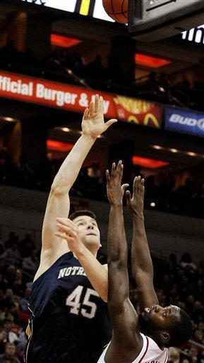 Notre Dame's Jack Cooley (45) shoots over Louisville's Rakeem Buckles during the first half of their NCAA college basketball game, Saturday, Jan. 7, 2012 in Louisville, Ky. (AP Photo/Timothy D. Easley)
