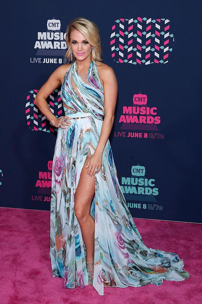 <p>Rocking a floral and watercolour print Mikael D. gown with a thigh-high slit to the CMT Music Awards in Nashville.<i> (Photo by Taylor Hill/FilmMagic)</i></p>