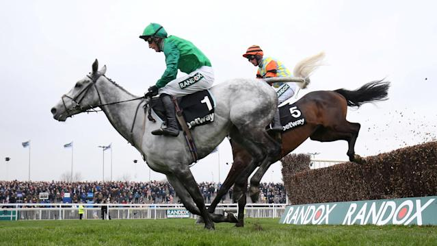 Horse Racing - Grand National Festival - Aintree Racecourse, Liverpool, Britain - April 12, 2018. Might Bite ridden by Nico de Boinville in action (R) before winning the 14:50 Betway Bowl Chase. Action Images via Reuters/Jason Cairnduff TPX IMAGES OF THE DAY