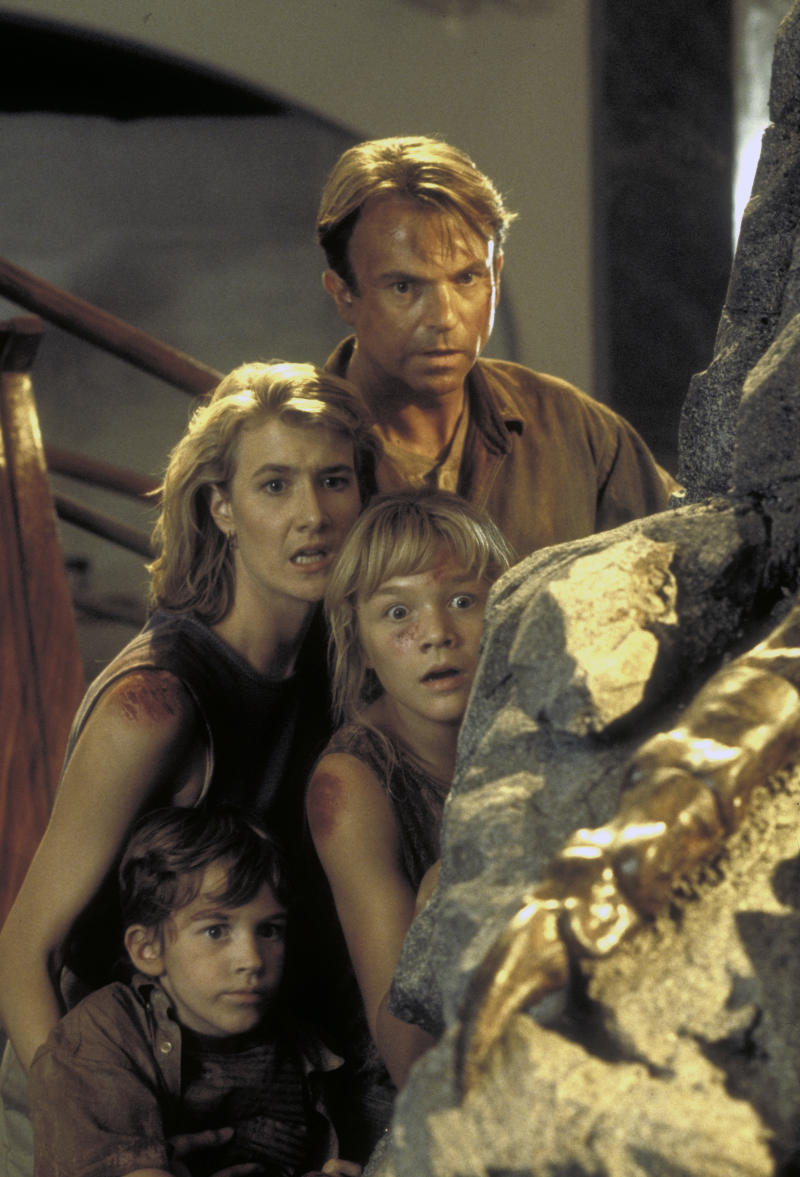 Actor Sam Neill as Dr. Alan Grant and actress Laura Dern as Dr. Ellie Sattler, with Ariana Richards (right) and Joseph Mazzello (left) as Lex and Tim, in a scene from the film 'Jurassic Park', 1993. (Photo by Murray Close/Getty Images)