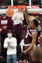 Texas A&M guard Quenton Jackson (3) dunks against New Orleans during the second half of an NCAA college basketball game Sunday, Nov. 29, 2020, in College Station, Texas. (AP Photo/Sam Craft)