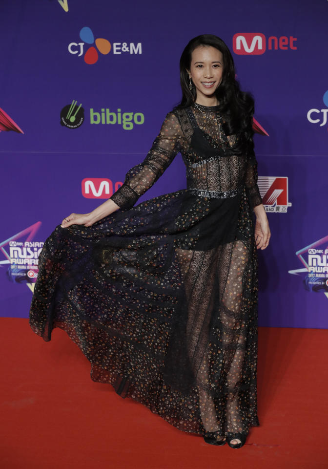 <p>Hong Kong singer-actress Karen Mok poses for photos on the red carpet of the Mnet Asian Music Awards (MAMA) in Hong Kong, Friday, Dec. 1, 2017. (AP Photo/Kin Cheung) </p>