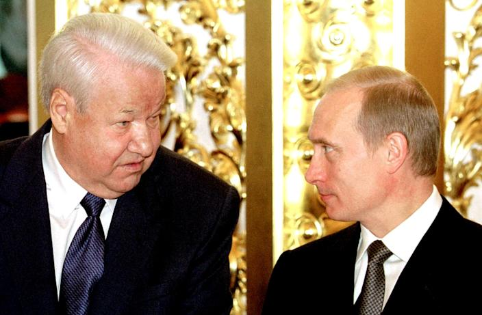 Russian President Vladimir Putin, right, with his predecessor Boris Yeltsin in 2001. (Reuters)