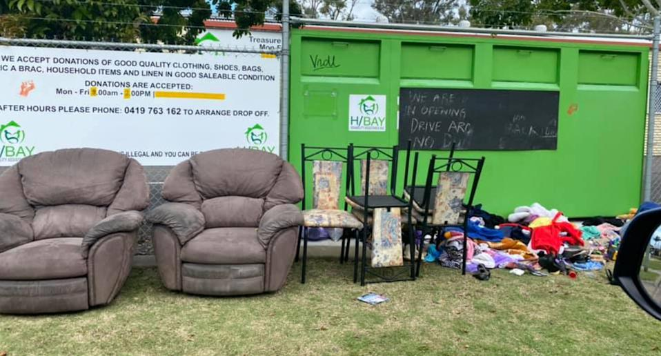 Lounges, chairs and clothing dumped on the ground at a Hervey Bay charity bin has sparked outrage.
