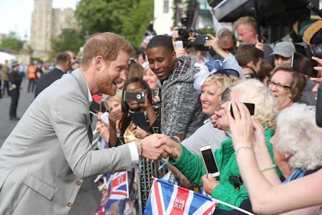 Prince Harry greets fans outside Windsor Castle ahead of his wedding to Meghan Markle this weekend. (Photo: Jonathan Brady/pool via Reuters)