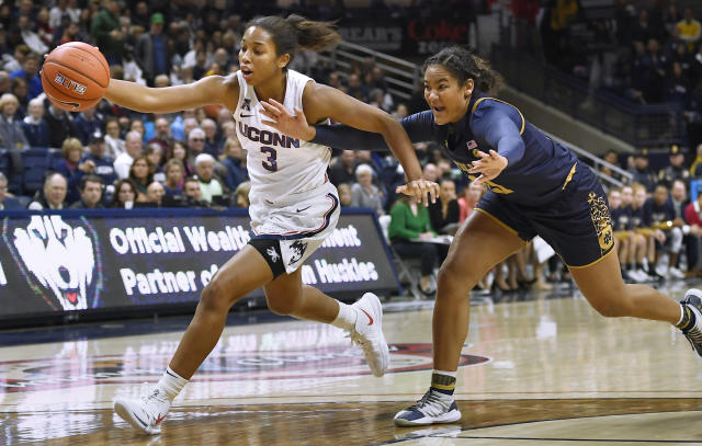 Connecticut's Megan Walker, left, is pursued by Notre Dame's Anaya Peoples in the second half of an NCAA college basketball game, Sunday, Dec. 8, 2019, in Storrs, Conn. (AP Photo/Jessica Hill)