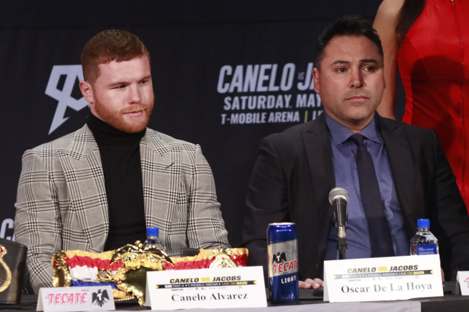 NEW YORK, NY - FEBRUARY 27: Chepo Ryenoso, Canelo Alvarez and Oscar De La Hoya at the Canelo Alvarez vs Daniel 'Miracle Man' Jacobs Middleweight Unification Fight Press Conference ahead of their May 4th , Cinco de Mayo weekend title fight. Hard Rock Times Square in New York City on February 27, 2019. Credit: Diego Corredor/MediaPunch /IPX