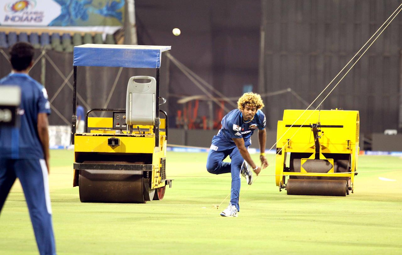 Lasith Malinga bowls during a Mumbai Indians nets session at the Wankhede Stadium in Mumbai on 8 April 2013. (Yogen Shah)