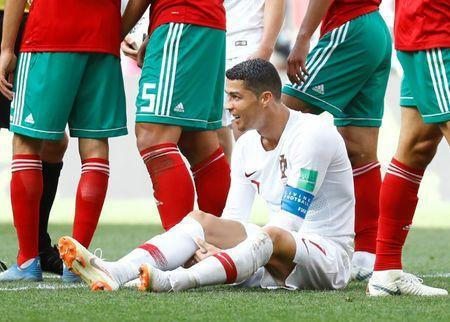 Soccer Football - World Cup - Group B - Portugal vs Morocco - Luzhniki Stadium, Moscow, Russia - June 20, 2018 Portugal's Cristiano Ronaldo after being fouled REUTERS/Kai Pfaffenbach